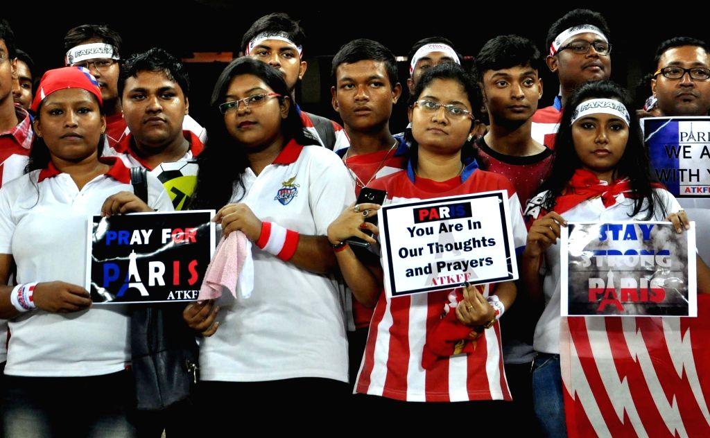 Atletico de Kolkata fans show solidarity with the victims of 13/11 Paris blasts at Salt Lake stadium ahead of the ISL match between Chennaiyin FC and Atletico de Kolkata in Kolkata, on Nov ...