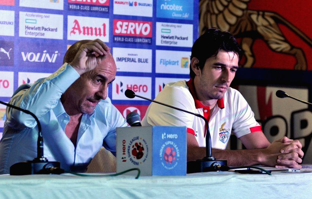 Atletico de Kolkata Head Coach Antonio Habas and player Dejan Lekic during a pre-match press conference in Kolkata, on Nov 17, 2015.