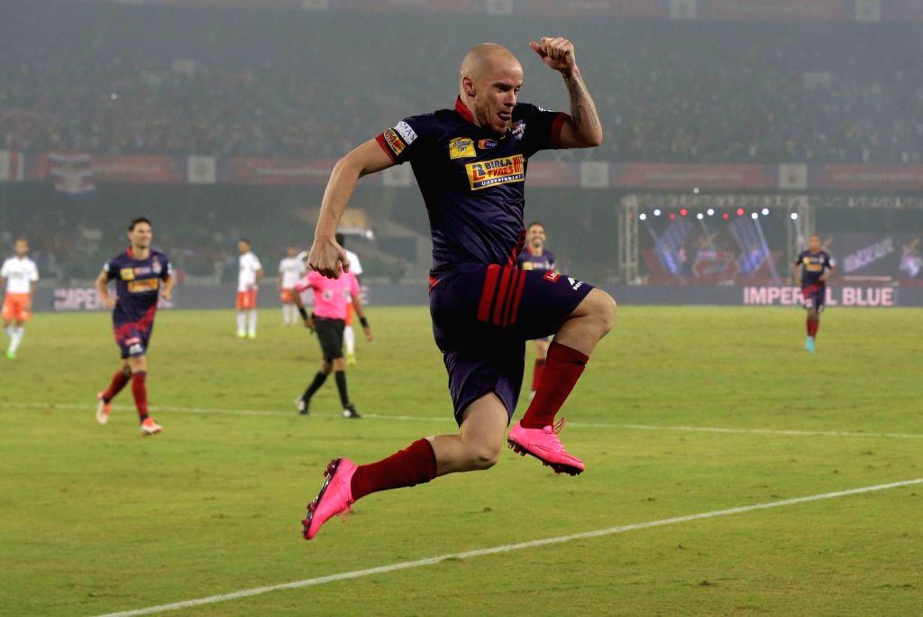 Atletico de Kolkata player Iain Hume celebrates after scoring a goal during an ISL match between Atletico de Kolkata and FC Pune City in Kolkata, on Nov 27, 2015.