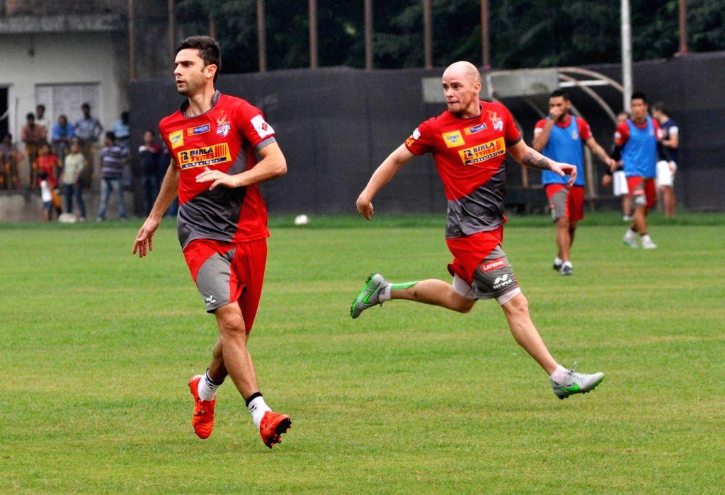 Atletico de Kolkata players in action during a practice session in Kolkata on Nov. 16, 2015.