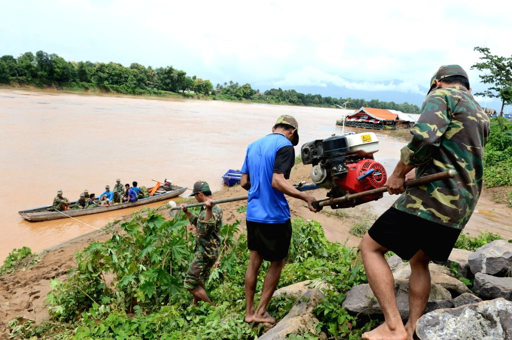 ATTAPEU, July 25, 2018 - Lao soldiers carry rescue equipments in Attapeu, Laos, on July 25, 2018. About 19 people were dead and 49 others remained missing after an under-construction dam collapsed in ...