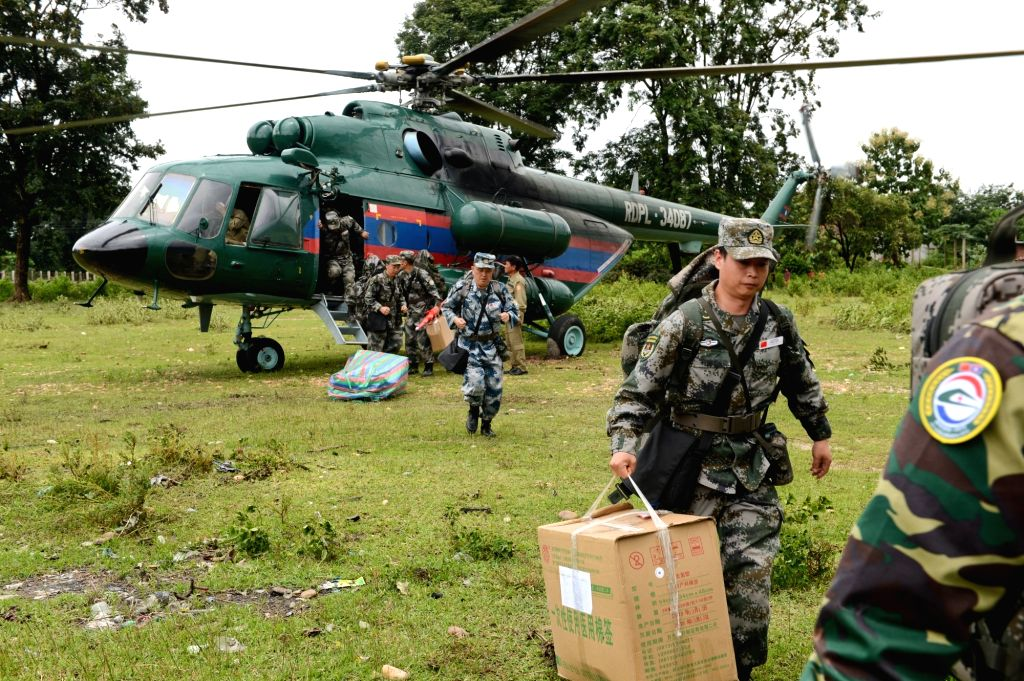 ATTAPEU, July 26, 2018 - A Chinese People's Liberation Army (PLA) medical team arrive at the flooded-area in Attapeu, Laos, July 26, 2018. A medical contingent from the Chinese People's Liberation ...