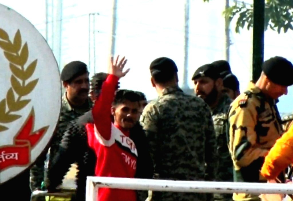 Attari: A 17-year-old Pakistani boy, Mubshar Bilal who returned to his native place to his country via Attari land border following completion of their jail sentence, in Attari on Jan 14, 2020. (Photo: IANS)