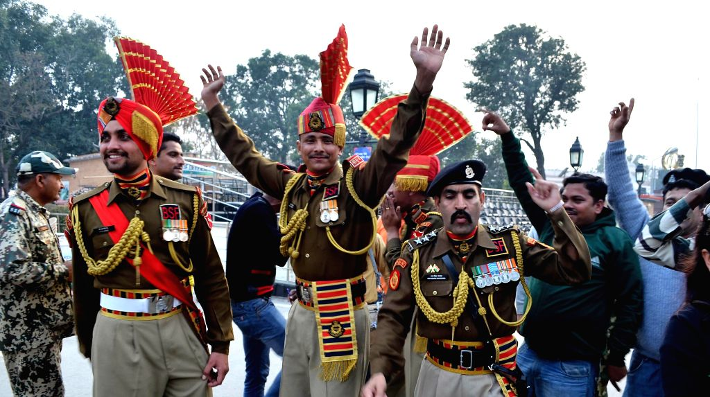 BSF soldiers celebrate India's victory over Pakistan in an ICC World Cup 2015 match, at Indo-Pak border in Attari, Punjab  on Feb 15, 2015.