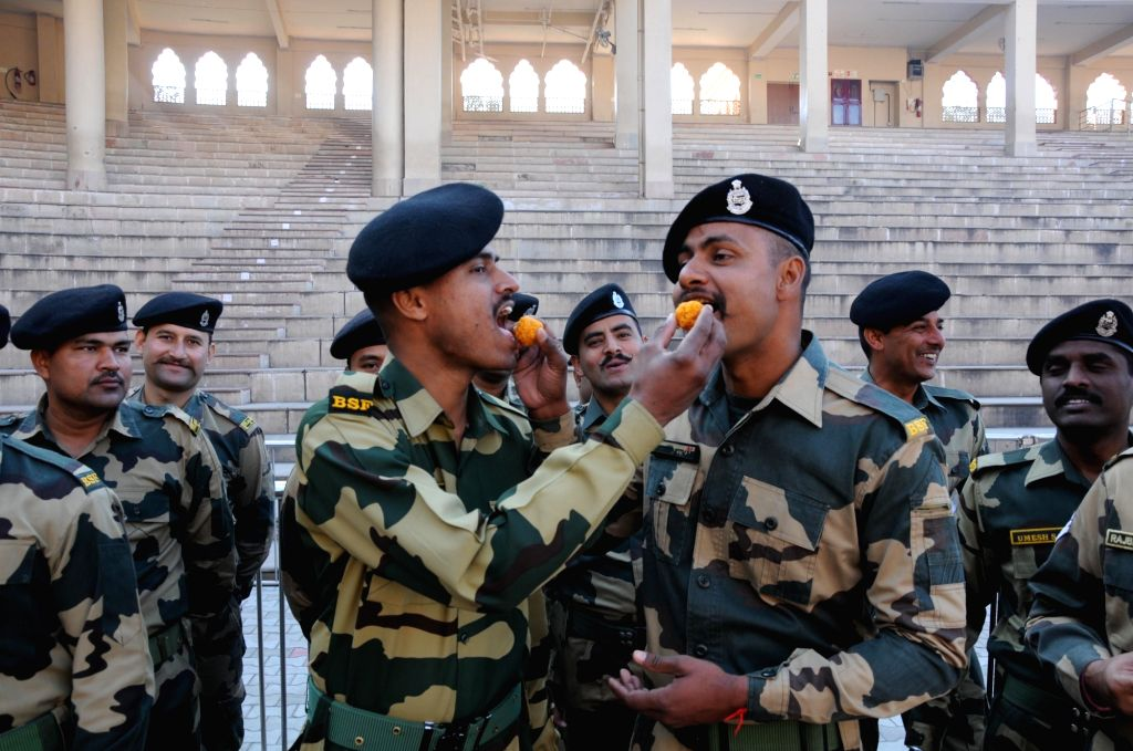 Attari: BSF soldiers exchange sweets during the 71st Republic Day celebrations at Indo-Pak border at Attari, near Amritsar on Jan 26, 2020. (Photo: IANS)