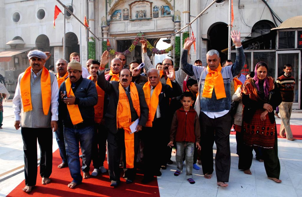 Hindu pilgrims leave for Pakistan to pay obeisance at Hindu temples in Pakistan's Lahore and Chakwal district, via Attari border in Punjab on Nov 25, 2014.