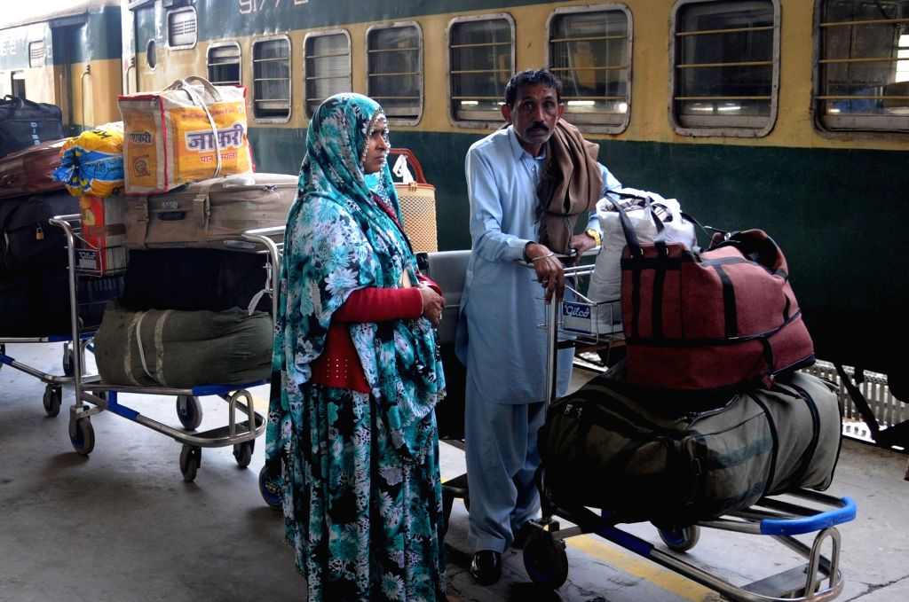 Attari: Passengers of Samjhauta Express arriving from Pakistan deboard at Attari railway station, in Punjab, India  on Feb 25, 2019. (Photo: IANS)