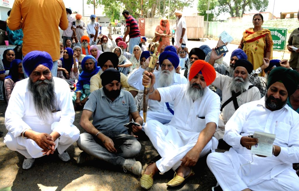 Attari: Pilgrims, who were supposed to cross over to Pakistan for observing the martyrdom day of Guru Arjan Dev, left stranded at the Attari railway station after they were not allowed to cross over despite having valid visas, for want of permission  - Arjan Dev
