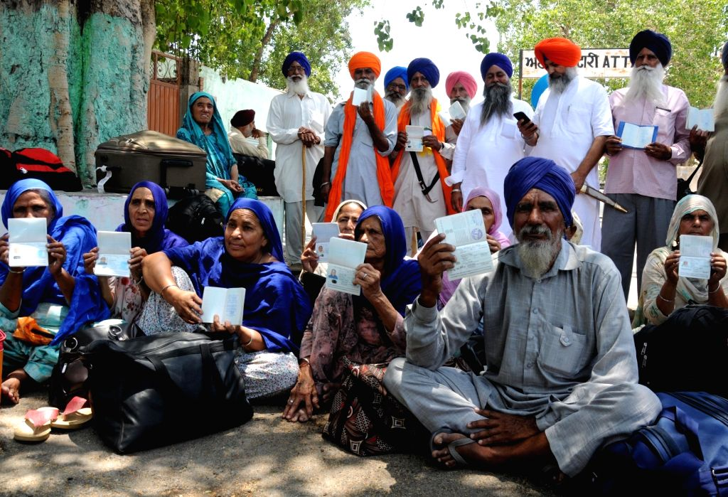 Attari: Pilgrims, who were supposed to cross over to Pakistan for observing the martyrdom day of Guru Arjan Dev, show their passports after they were not allowed to cross over from the Attari railway station despite having valid visas, for want of pe - Arjan Dev