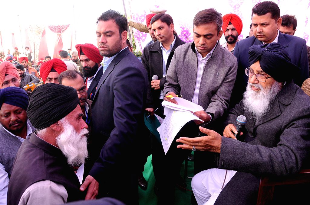 Punjab Chief Minister Parkash Singh Badal interacts with people during a programme in Attari on Dec 11, 2014. - Parkash Singh Badal