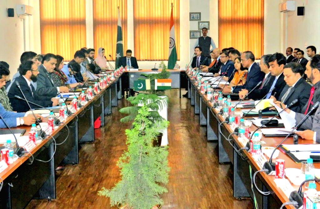 Attari:: Talks between India and Pakistan to discuss and finalize the modalities for the Kartarpur Corridor at Attari in Amritsar, that'll facilitate Indian pilgrims to visit the holy shrine of Gurudwara Darbar Sahib Kartarpur, underway in