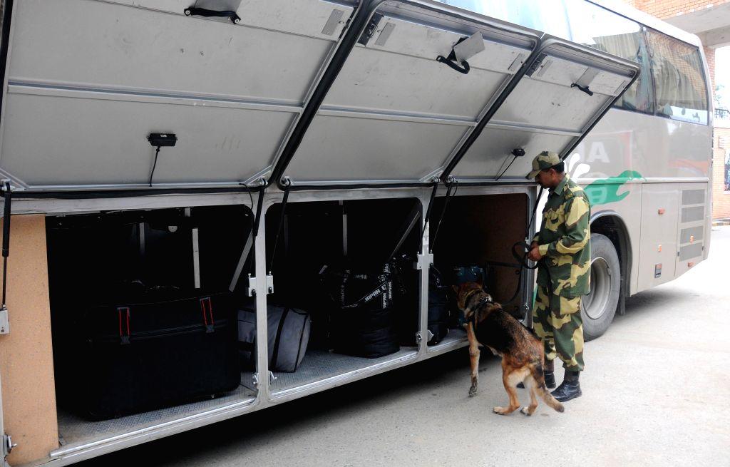 Attari-Wagah border: A BSF personnel checks a Lahore-Delhi bus which arrived in India at Attari-Wagah border, on Aug 15, 2015.