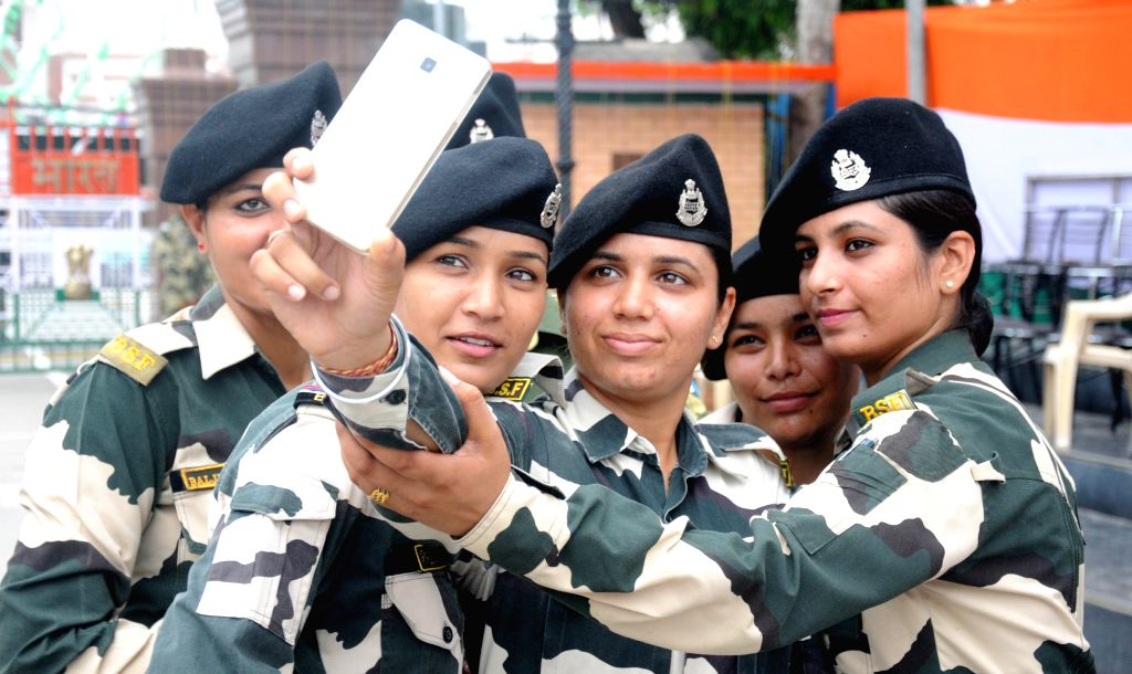 Attari-Wagah border: BSF personnel click a selfie on the occasion of 69th ``Independence Day`` celebration at Attari-Wagah border, on Aug 15, 2015.
