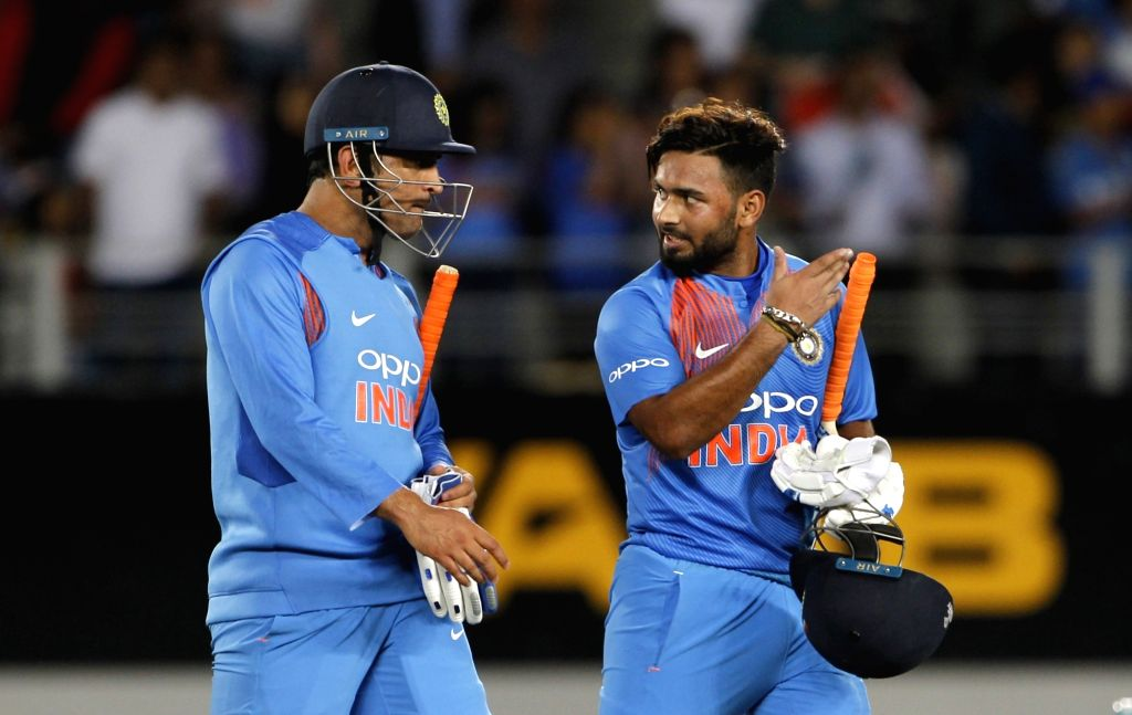 Auckland: India's MS Dhoni and Rishabh Pant celebrate after winning the second T20I match against New Zealand at Eden Park in Auckland, New Zealand on Feb 8, 2019. (Photo: Surjeet Yadav/IANS) - MS Dhoni and Surjeet Yadav