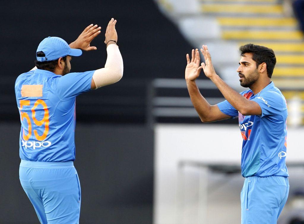Auckland (New Zealand): India's Bhuvneshwar Kumar celebrates the wicket of Tim Seifert with captain Rohit Sharma during the second T20I match between India and New Zealand at Eden Park in Auckland, New Zealand on Feb 8, 2019. (Photo: Surjeet Yadav/IA - Rohit Sharma, Bhuvneshwar Kumar and Surjeet Yadav