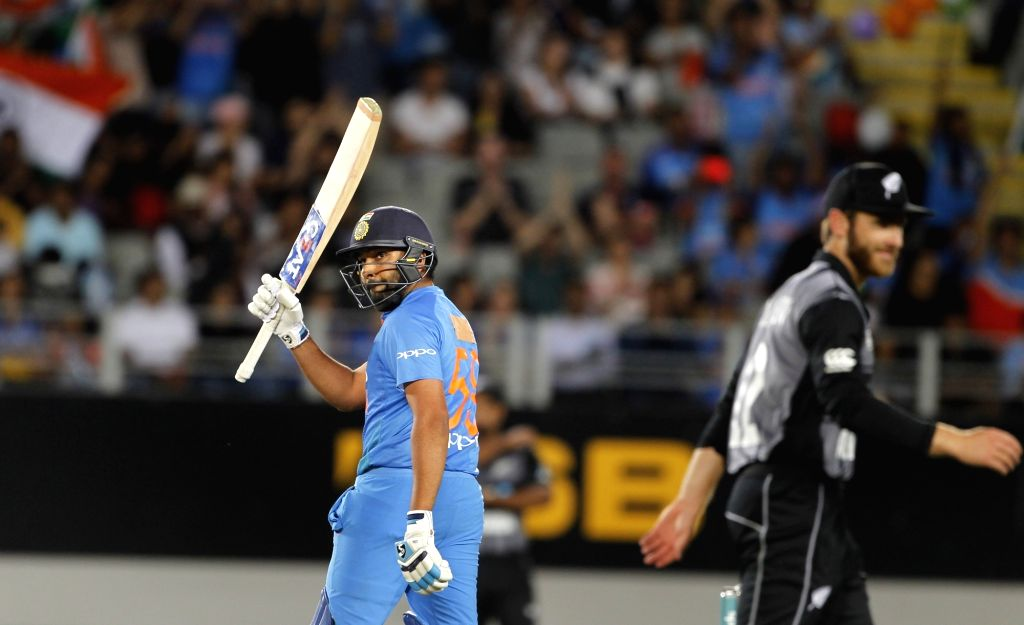 Auckland (New Zealand): Indian captain Rohit Sharma celebrates his half-century during the second T20I match between India and New Zealand at Eden Park in Auckland, New Zealand on Feb 8, 2019. (Photo: Surjeet Yadav/IANS) - Rohit Sharma and Surjeet Yadav
