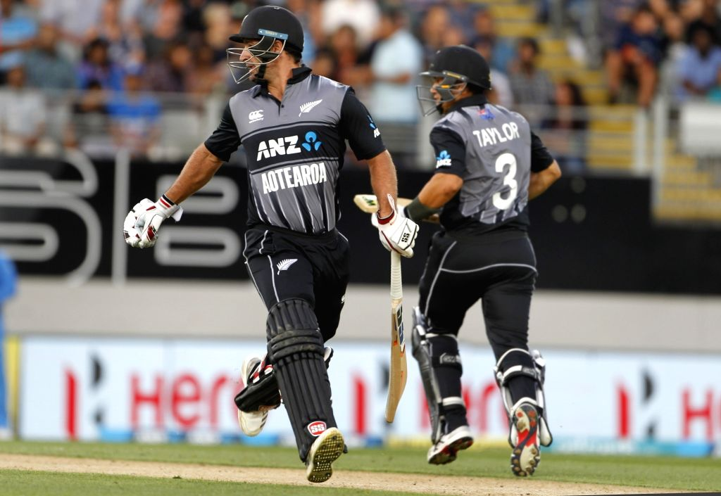 Auckland (New Zealand): New Zealand's Colin de Grandhomme and Ross Taylor during the second T20I match between India and New Zealand at Eden Park in Auckland, New Zealand on Feb 8, 2019. (Photo: Surjeet Yadav/IANS) - Surjeet Yadav