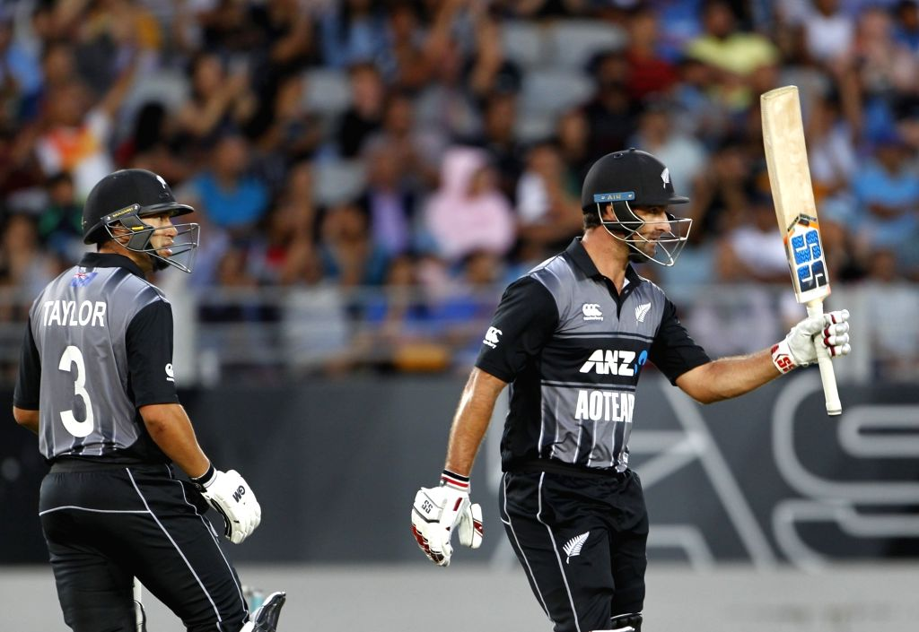 Auckland (New Zealand): New Zealand's Colin de Grandhomme celebrates his half-century during the second T20I match between India and New Zealand at Eden Park in Auckland, New Zealand on Feb 8, 2019. Also seen New Zealand's Ross Taylor. (Photo: Surjee - Surjeet Yadav