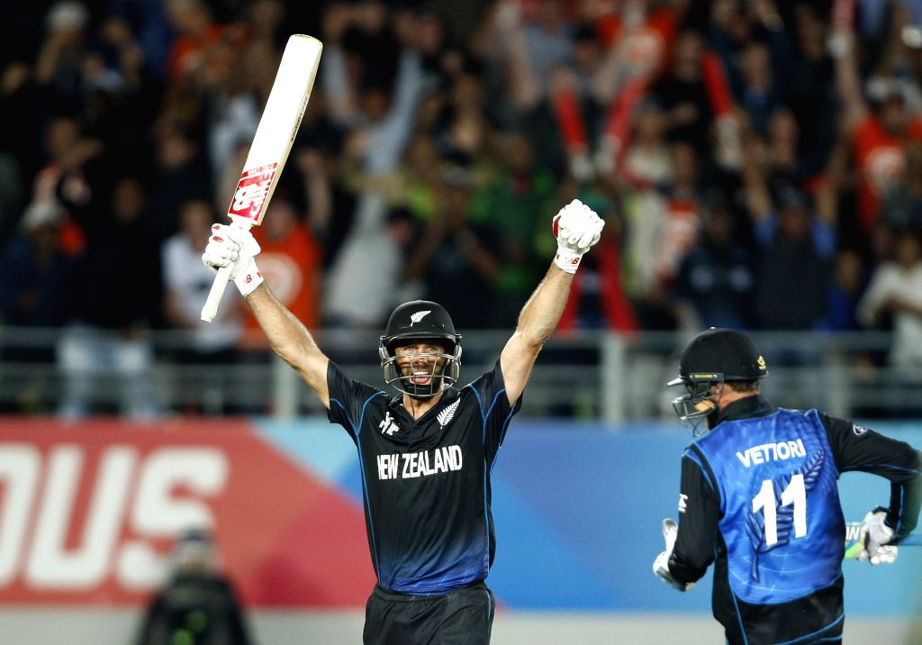 New Zealand player Grant Elliott celebrates after hitting a winning sixer during the first semi-final match of ICC World Cup 2015 between New Zealand and South Africa at Eden Park, ...