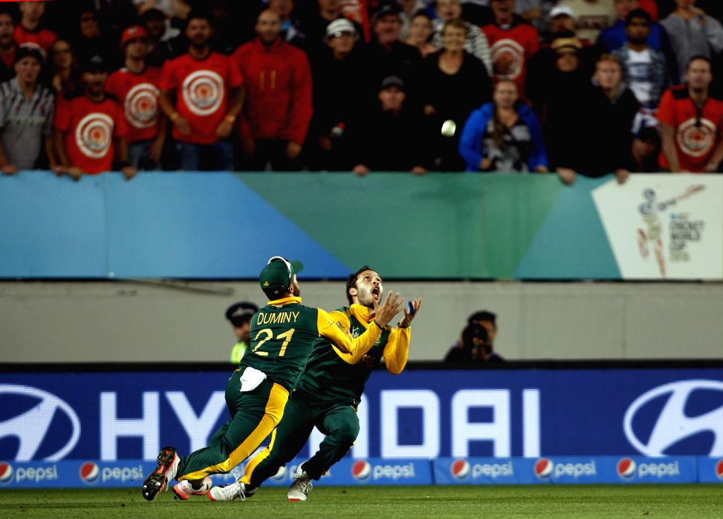 South African players Farhaan Behardien and J P Duminy bump into each other and miss the wicket of Grant Elliott during the first semi-final match of ICC World Cup 2015 between New Zealand ...