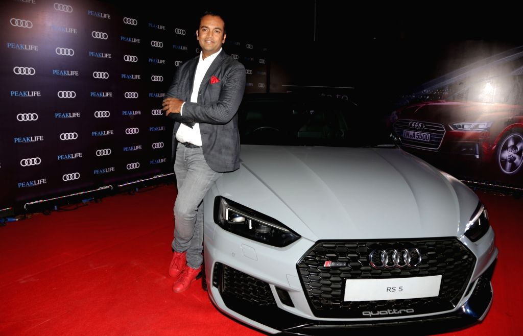 Audi India Head Rahil Ansari poses with the Audi RS 5 Coupe at Audi Peaklife Fashion Capsule in New Delhi, on April 5, 2019.