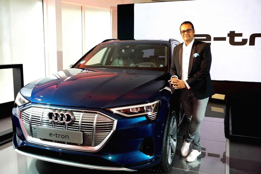 Audi India Head Rahil Ansari poses with the newly launched electric SUV Audi e-tron, in Gurugram on Aug 2, 2019.