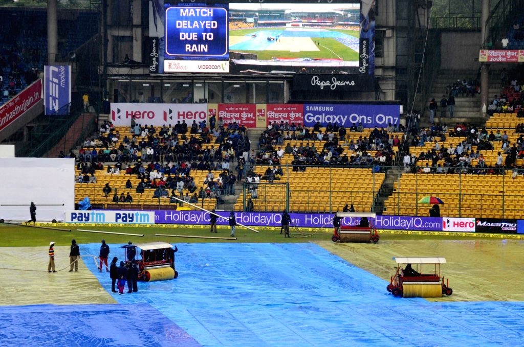 Audience wait at the stand as rain delay the start of the 2nd day of the second test match between India and South Africa at M Chinnaswamy Stadium in Bengaluru, on Nov 15, 2015.