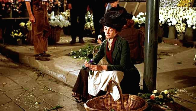 """Audrey Hepburn as flower girl Eliza Doolittle in the film version of \""""My Fair Lady\"""", based on Shaw\'s play"""