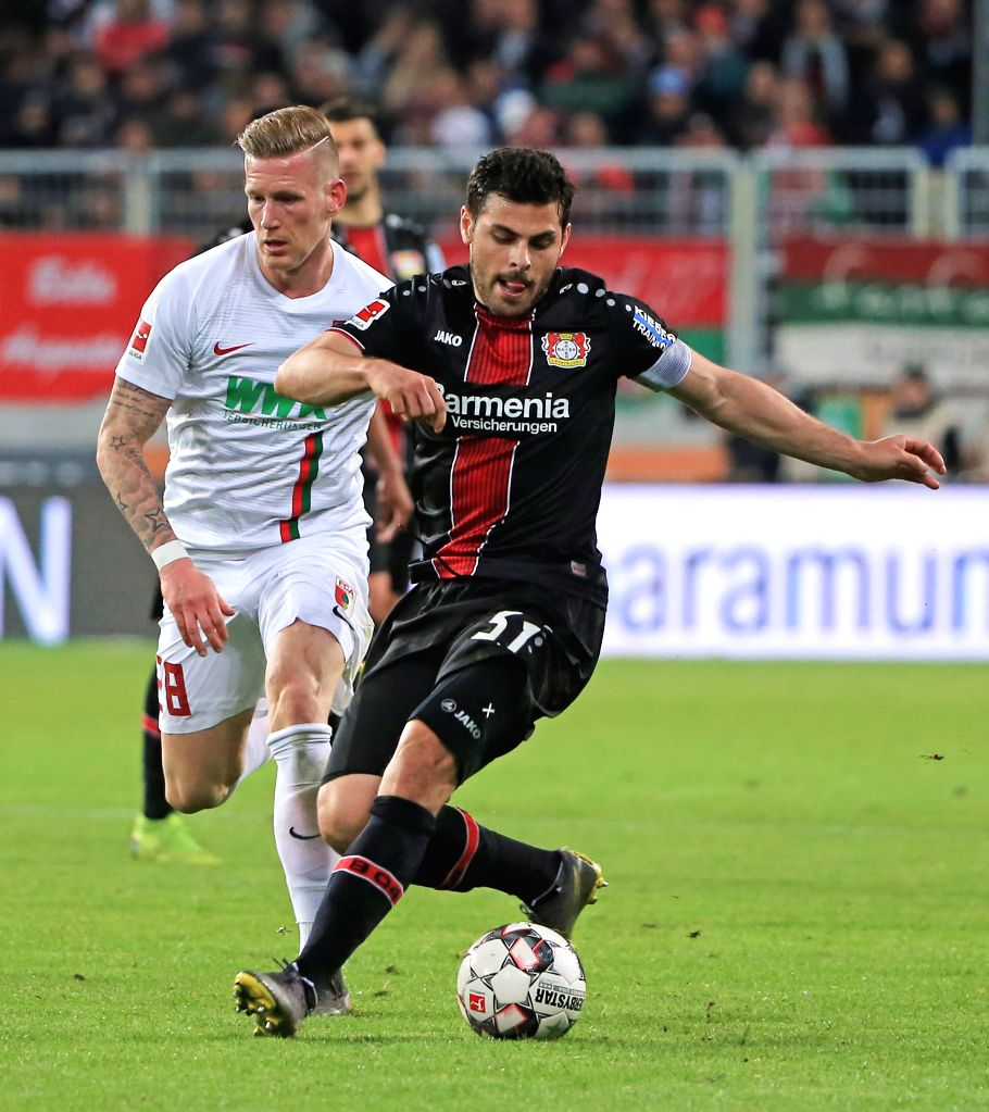 AUGSBURG, April 27, 2019 - Leverkusen's Kevin Volland (R) controls the ball during a German Bundesliga match against FC Augsburg in Augsburg, Germany, on April 26, 2019. Leverkusen won 4-1.
