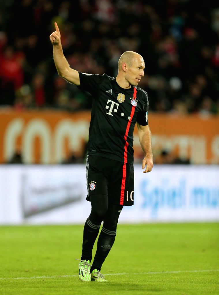 Bayern Munich's player Arjen Robben celebrates his goal during the German first division Bundesliga football match between Bayern Munich and Augsburg in Augsburg, .