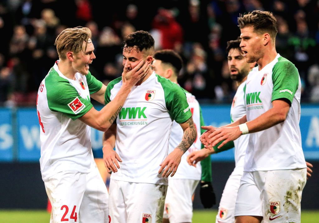 AUGSBURG, Dec. 8, 2019 - Marco Richter (2nd L) of Augsburg celebrates with Fredrik Jensen (1st L) during a German Bundesliga match between FC Augsburg and 1.FSV Mainz 05 in Augsburg, Germany, on Dec. ...