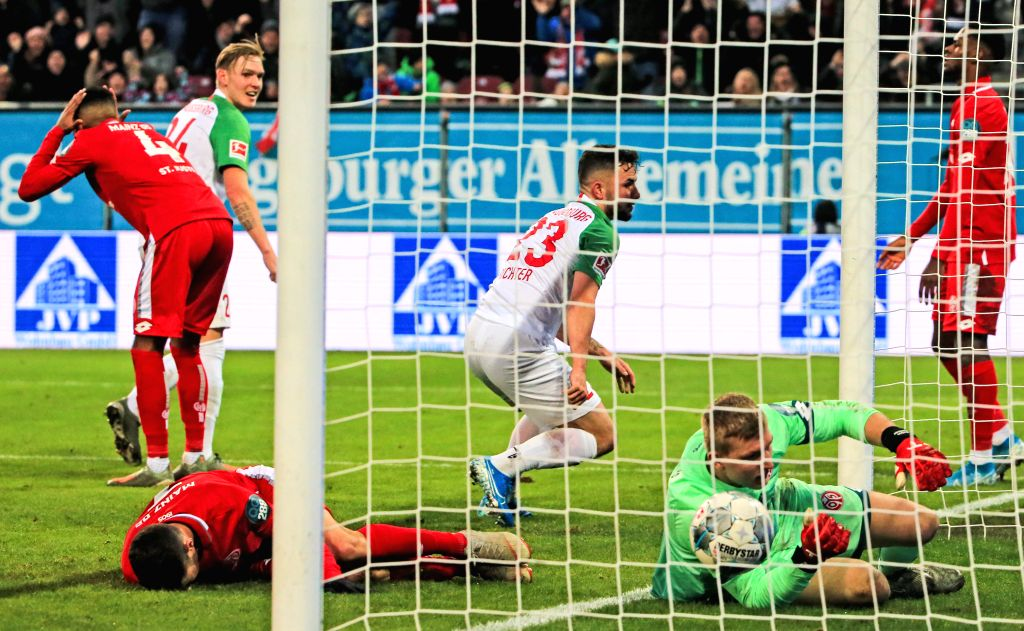 AUGSBURG, Dec. 8, 2019 - Marco Richter (3rd R) of Augsburg celebrates scoring during a German Bundesliga match between FC Augsburg and 1.FSV Mainz 05 in Augsburg, Germany, on Dec. 7, 2019.