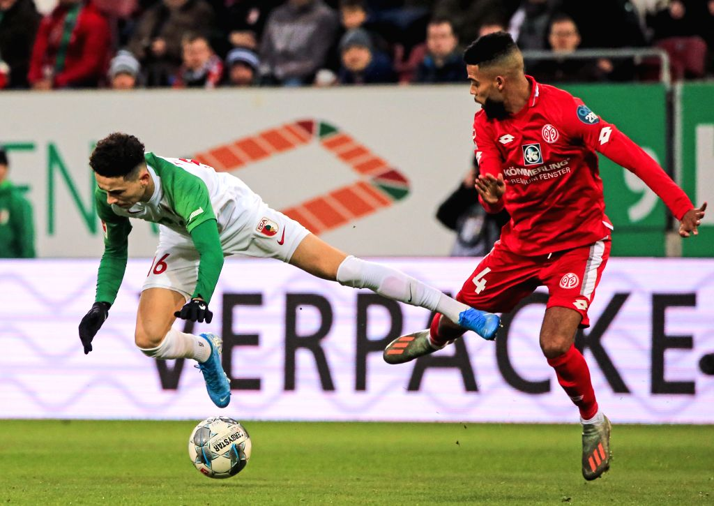 AUGSBURG, Dec. 8, 2019 - Ruben Vargas (L) of Augsburg vies with Jeremiah St. Juste of Mainz during a German Bundesliga match between FC Augsburg and 1.FSV Mainz 05 in Augsburg, Germany, on Dec. 7, ...