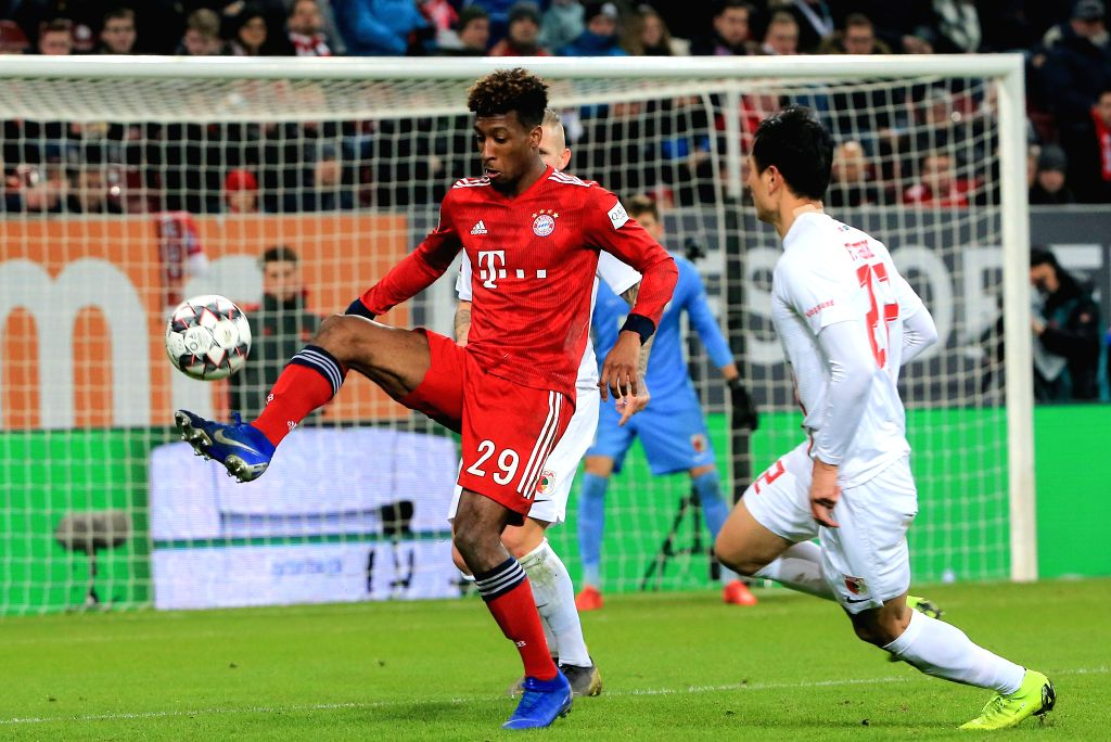 AUGSBURG, Feb. 16, 2019 - Bayern Munich's Kingsley Coman (L) vies with Augsburg's Ji Dong-won during a German Bundesliga match between FC Augsburg and Bayern Munich in Augsburg, Germany, Feb. 15, ...
