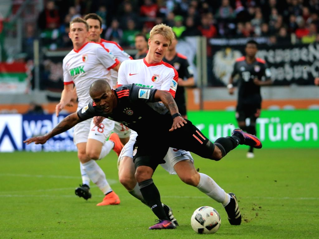 AUGSBURG, Oct. 30, 2016 - Bayern Munich's Douglas Costa (Front) vies for the ball with FC Augsburg's Martin Hinteregger during the German Bundesliga soccer match between FC Augsburg and FC Bayern ...