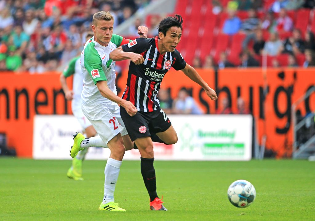 AUGSBURG, Sept. 15, 2019 - Alfred Finnbogason (L) of Augsburg vies with Makoto Hasebe of Frankfurt during a German Bundesliga match between FC Augsburg and Eintracht Frankfurt in Augsburg, Germany, ...