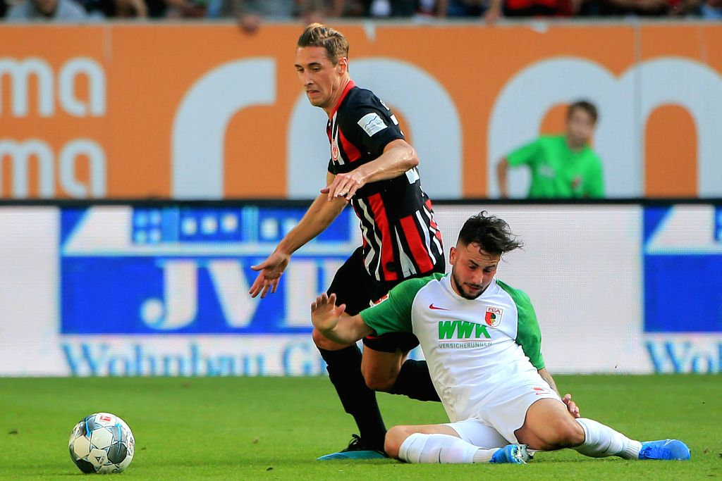 AUGSBURG, Sept. 15, 2019 - Dominik Kohr (up) of Frankfurt vies with Marco Richter of Augsburg during a German Bundesliga match between FC Augsburg and Eintracht Frankfurt in Augsburg, Germany, on ...