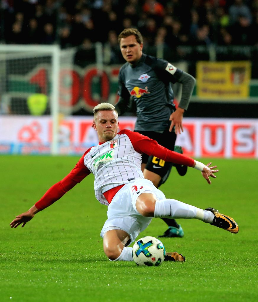 AUGSBURG, Sept. 20, 2017 - Augsburg's Philipp Max (Front) slide tackles during a German Bundesliga match between FC Augsburg and RB Leipzig, in Augsburg, Germany, on Sept. 19, 2017. RB Leipzig lost ...