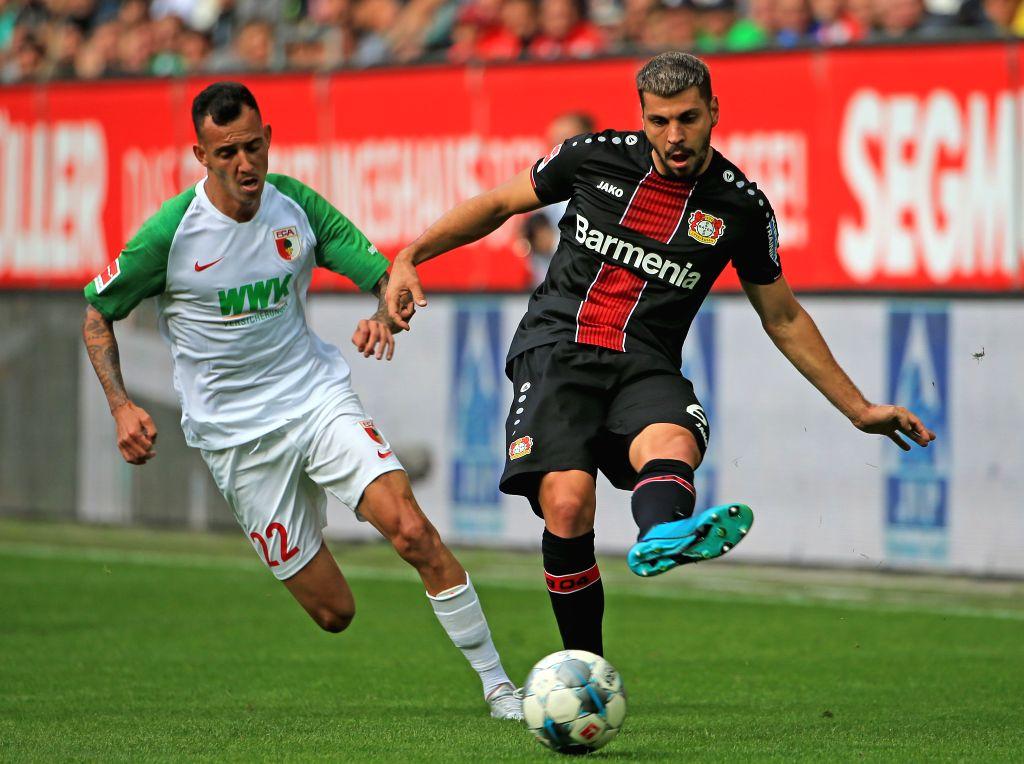 AUGSBURG, Sept. 29, 2019 - Aleksandar Dragovic (R) of Bayer 04 Leverkusen vies with Iago Amaral Borduchi of Augsburg during a German Bundesliga match between Bayer 04 Leverkusen and FC Augsburg in ...