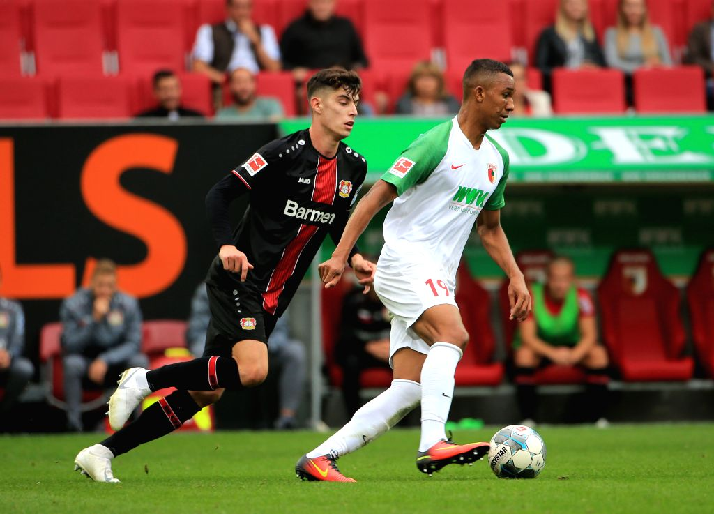 AUGSBURG, Sept. 29, 2019 - Kai Havertz (L) of Bayer 04 Leverkusen vies with Ohis Felix Uduokhai of Augsburg during a German Bundesliga match between Bayer 04 Leverkusen and FC Augsburg in Augsburg, ...