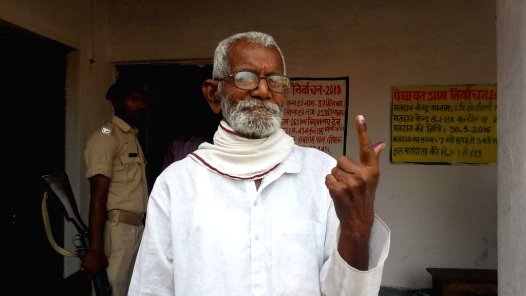 Aurangabad: An elderly man shows his inked finger after casting his vote for the 2019 Lok Sabha elections in Bihar's Aurangabad, on April 11, 2019. (Photo: IANS)