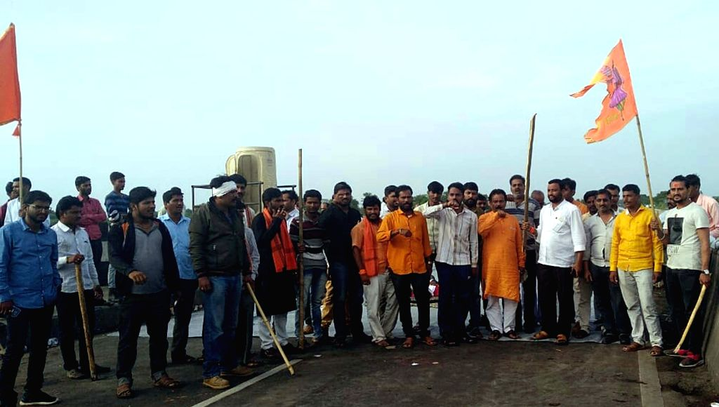 :Aurangabad: Maratha Kranti activists go on rampage as they stage a demonstration to press for a Maratha quota, in Aurangabad on July 24, 2018. A policemen and two others were injured as the ...