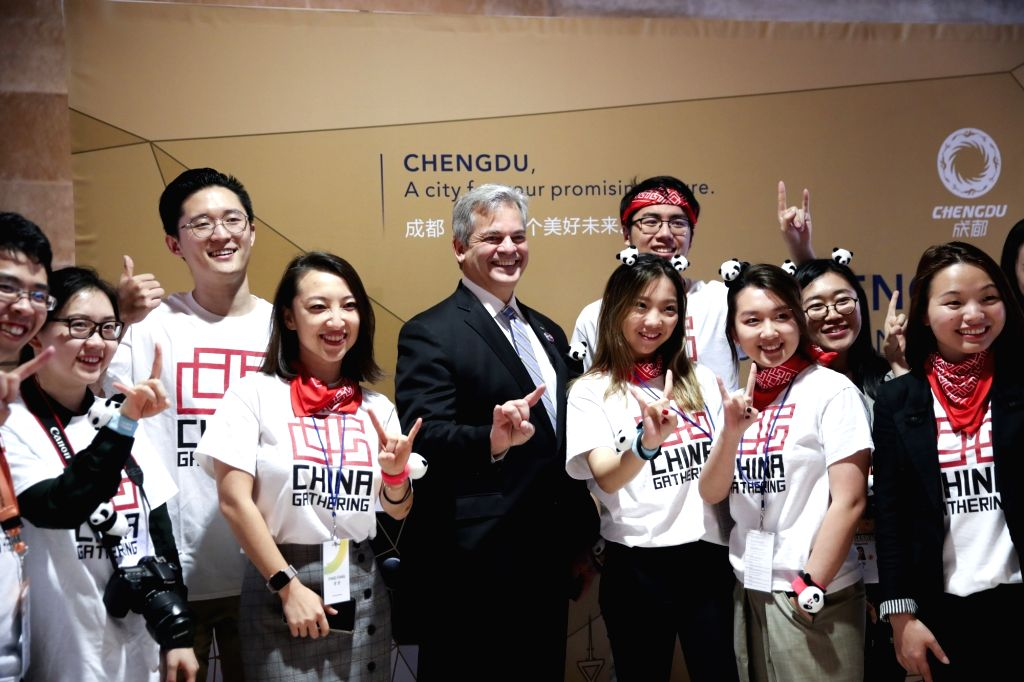 AUSTIN (U.S.), March 9, 2019 Steve Adler (C), mayor of Austin, U.S. state of Texas, poses for a photo with volunteers and working staff at an event promoting southwest China's city of ...