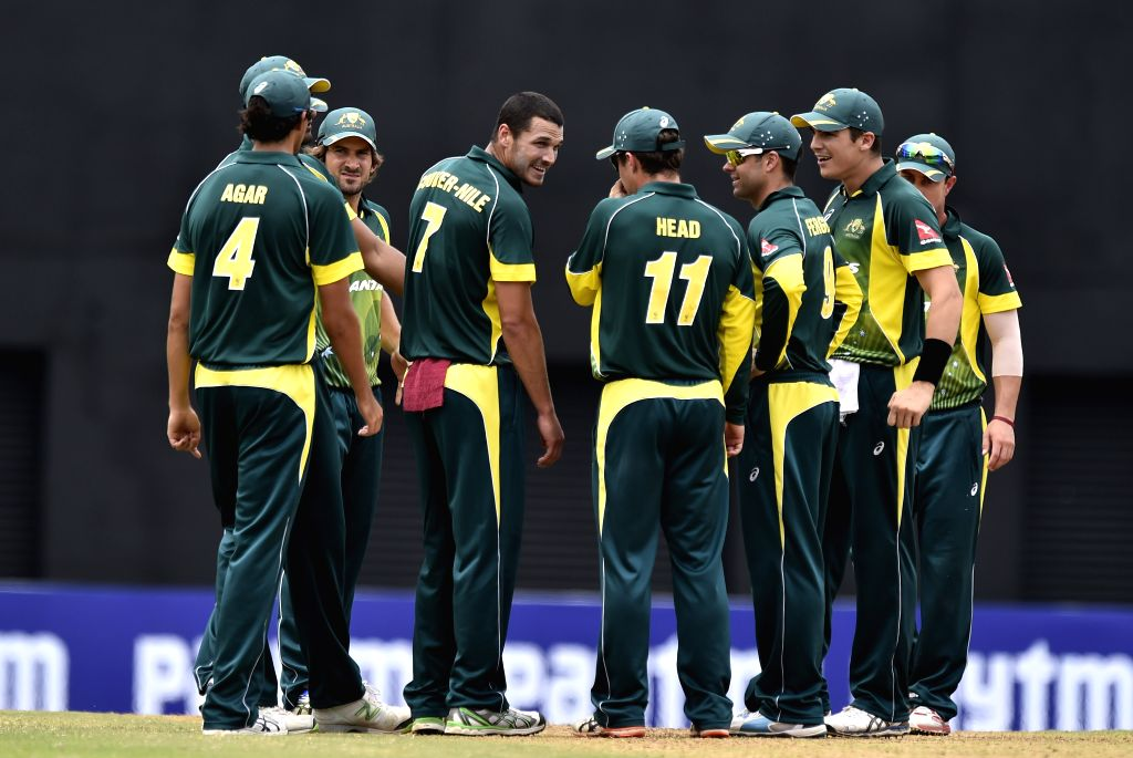 Australia `A` players celebrate fall of a wicket during `India A Team Triangular Series` match between South Africa `A` and Australia `A` at MAC Stadium in Chennai, on Aug 12, 2015.