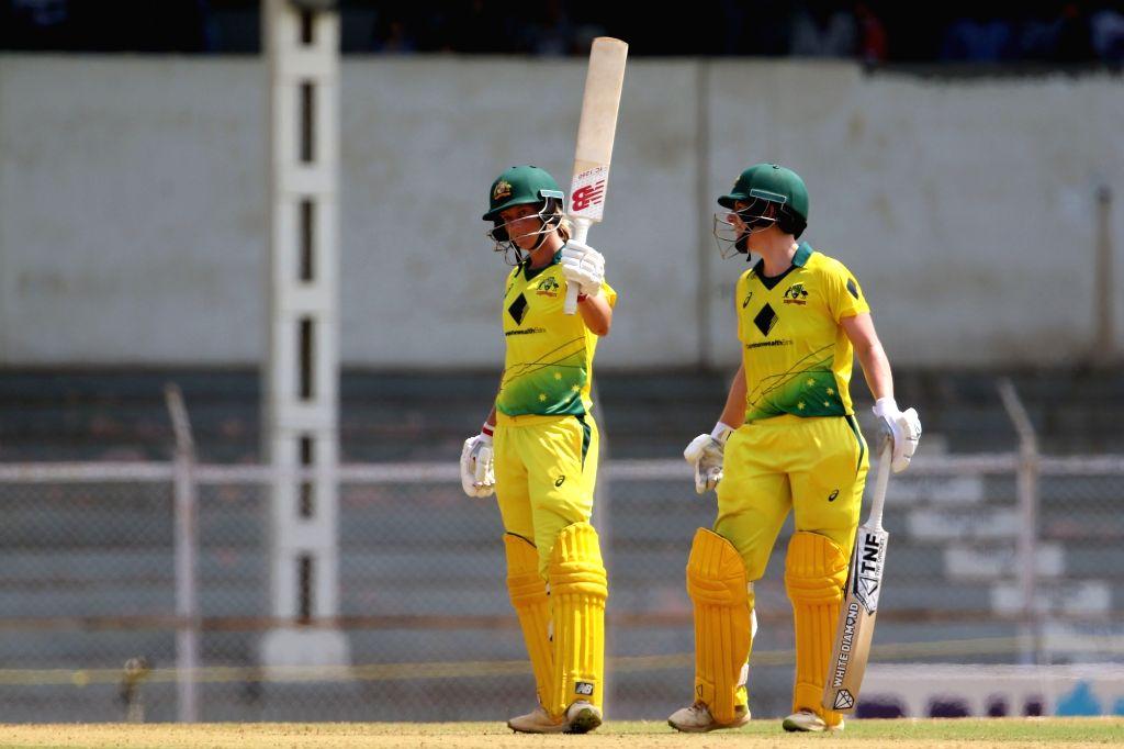 Australia captain Meg Lanning celebrates her half century during the women's tri-series Final T20I match between Australia and England at the Brabourne Stadium in Mumbai on March 31, 2018. - Meg Lanning