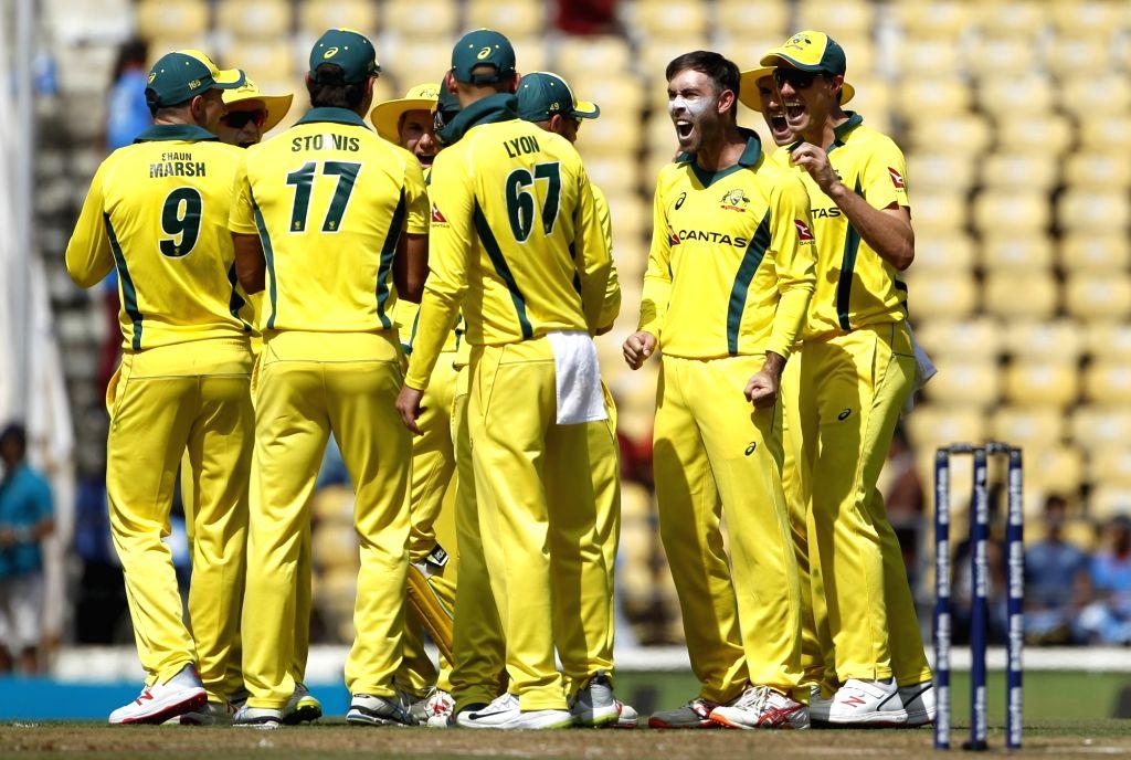 Australia's Glenn Maxwell celebrates fall of Shikhar Dhawan's during the second ODI match between India and Australia at Vidarbha Cricket Association (VCA) Stadium, in Nagpur, on March 5, ...
