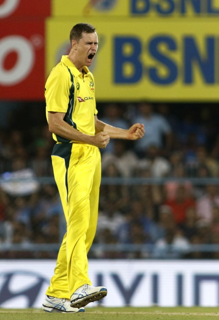 Australia's Jason Behrendorff, celebrates fall of Manish Pandey's wicket during the second T20 match between India and Australia at Barsapara Cricket Stadium in Guwahati on Oct 10, 2017. - Manish Pandey