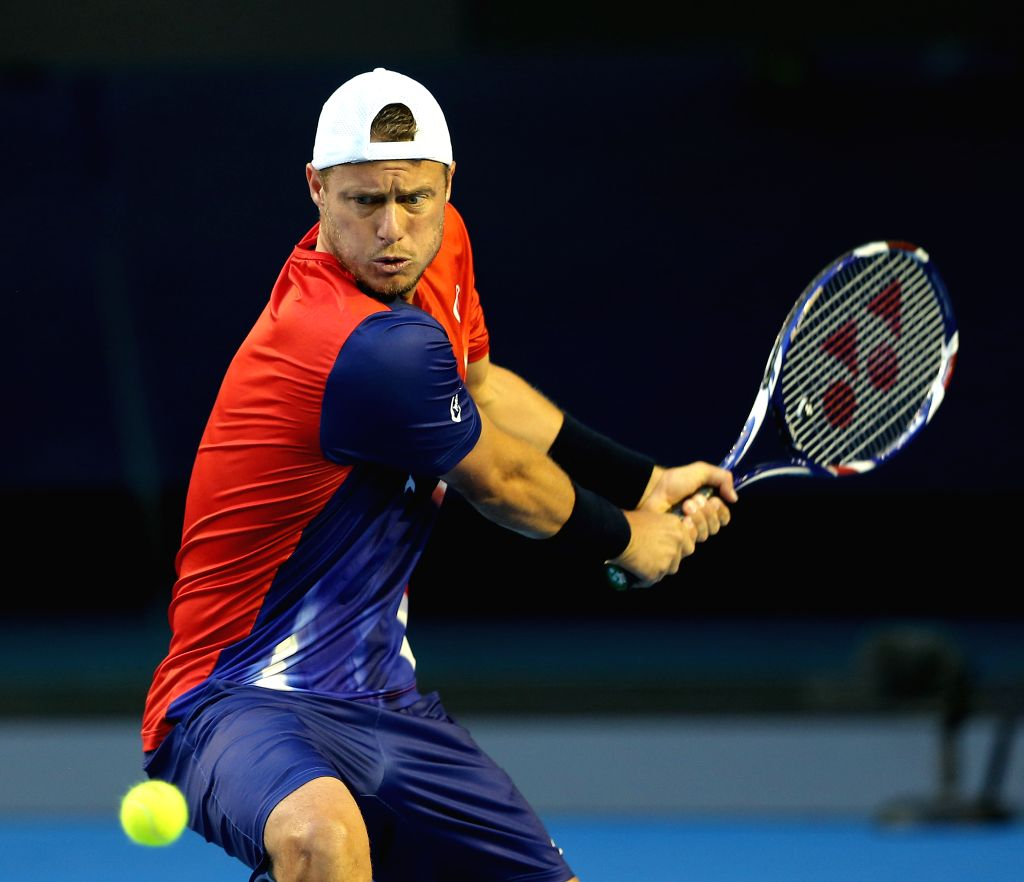 Australia's Lleyton Hewitt competes against his compatriot James Duckworth during the first round match of men's singles at the Australian Open Tennis ...