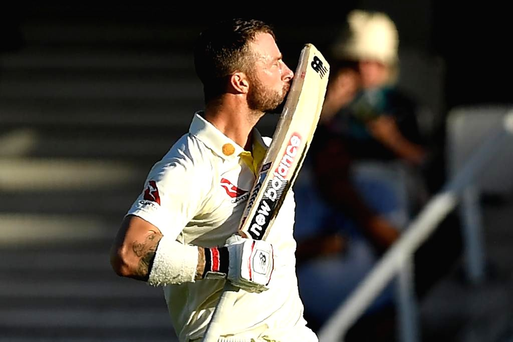 Australia's Matthew Wade celebrates his century on Day 4 of the 5th Test match between England and Australia at Kennington Oval in London on Sep 15, 2019.