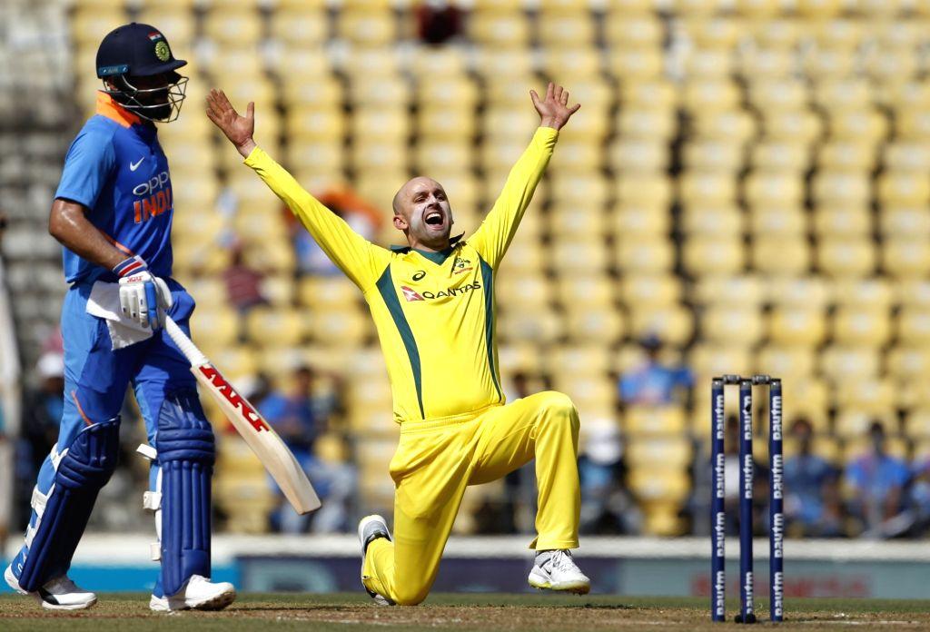 Australia's Nathan Lyon celebrates fall of Ambati Rayudu's wicket during the second ODI match between India and Australia at Vidarbha Cricket Association (VCA) Stadium, in Nagpur, on March 5, ...